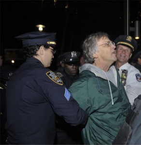 Combat medic Mike Hastie is taken away in handcuffs.