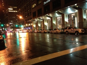 Police cars line up along Water Street in anticipation of multiple arrests made two hours later.